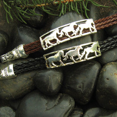 "Capturing the beauty and freedom of the horse, this bracelet is a stylish piece for all ages. Available on black or brown cord, this bracelet is a timeless piece of jewelry perfect for every horse lover.  • Made of Rhodium plated metal alloy and synthetic braided leather • Each piece is lead free / nickle free / hypo-allergenic • Bracelet measures 7"" long • The magnetic closure secures the bracelet while making it easier put on and off. • From the Wyo-Horse horse jewelry collection • Created by jewelry designer Kerstin Stock"