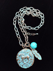 "Patina finished Hammered Running Horse Necklace with Turquoise Bead and Feather This horse medallion measures 1 1/4"" tall. The link chain measures 18"" long with a 2"" extender All lead free, nickel free, hypo-allergenic.  Designed exclusively by Kerstin Stock for Wyo-Horse Jewelry"