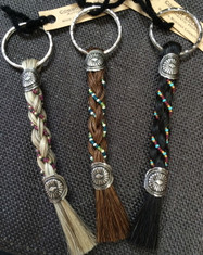 Horse Hair Key Chains were Cowboy Collectible's first product!  The owner made her first key chain on the banks of a river in Montana over eighteen years ago and their products are still handmade in Montana to this day. These key chains are available with colorful bead work accents.  Approx. 6 inches in length including the key ring.
