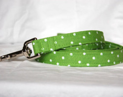 """Gree Polka Dot Chasin' Tail Leash  Chasin' Tail Doggie Designs are special handmade creations.  Each piece is made by hand, with care, in Boring Oregon.  Chasin' Tail handcrafted leashes are 5 feet in lenght available in 3 widths.  They feature a durable swivel hook.  Leashes are made from a washable fabric.  Gently wash and hang to dry.  Chasin' Tail dog leashes can be ironed with a cool iron to remove wrinkles if they should appear.  Chasin' Tail leashes come in the following widths.   SM 5/8"""" wide  Med 3/4"""" wide  LG  1"""" wide  Chasin' Tail also offers matching handmade collars and cute collar accessories like Bow Ties and Flowers.  Look for them to order and complete your pet's special look."""