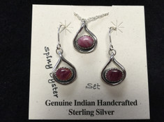 "Spiny Oyster ""stones"" are beautiful set in this Sterling Silver drop earrings and matching pendent set. This set features stones that have a purpleish color.  Spiny Oyster is truly made from Spiny Oyster shells.   These oysters have shells that range in colors and shades from pinks, reds, oranges, browns, yellows and even purples.  These are genuine Indian handcrafted Sterling Silver items.  Chain is included with set.  Earrings and pendent measure approx. 1/2 in. long."