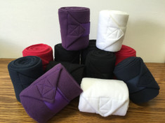 "Polo Wraps made with durable Polar Fleece by Partrade to conform to your horses legs during work. Available in Red, Purple, Navy, White and Black.   Measure 5"" wide and 8.2' in length.  Set of 4 bandages"
