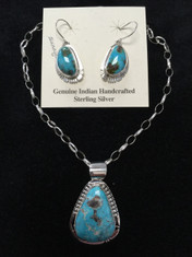 Genuine Indian Handcrafted Sterling Silver with Sunnyside Turquoise.  Beautiful SunnysideTurquoise set in Sterling Silver makes this Pendant and Earring set very unique.  The gorgeous pendant is on a 18 inch Sterling Silver chain.  Pendant measure about 1.25 inches in length and weighs .64 oz.  Earrings measure about .75 inches in length not including the post, and weigh .32 oz together.