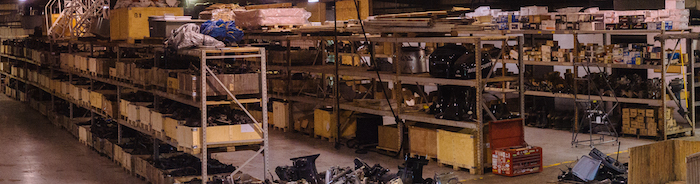 Large row of used and remanufactured sterndrive and outboard boat parts