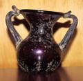 Ancient Roman colored glass bottle