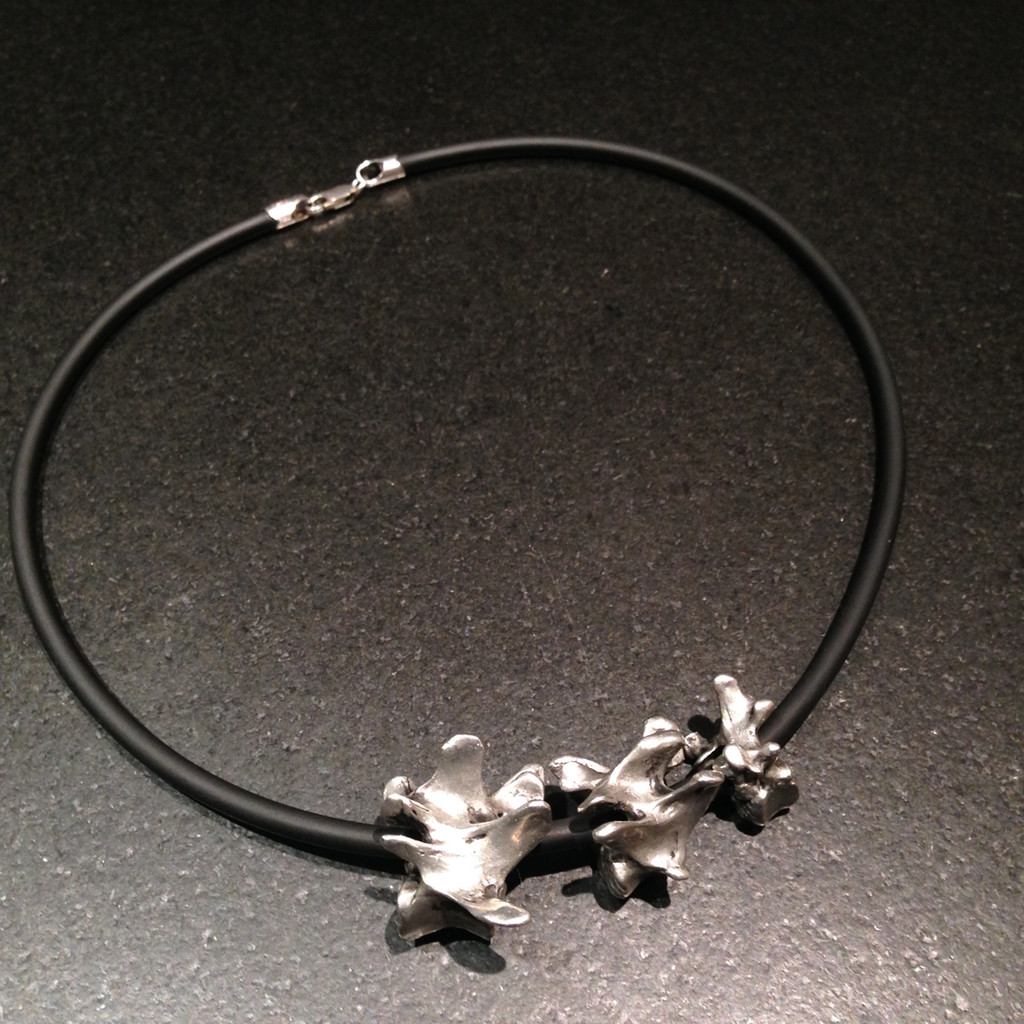 Pewter Cast Lumbar Vertebrae on rubber cord