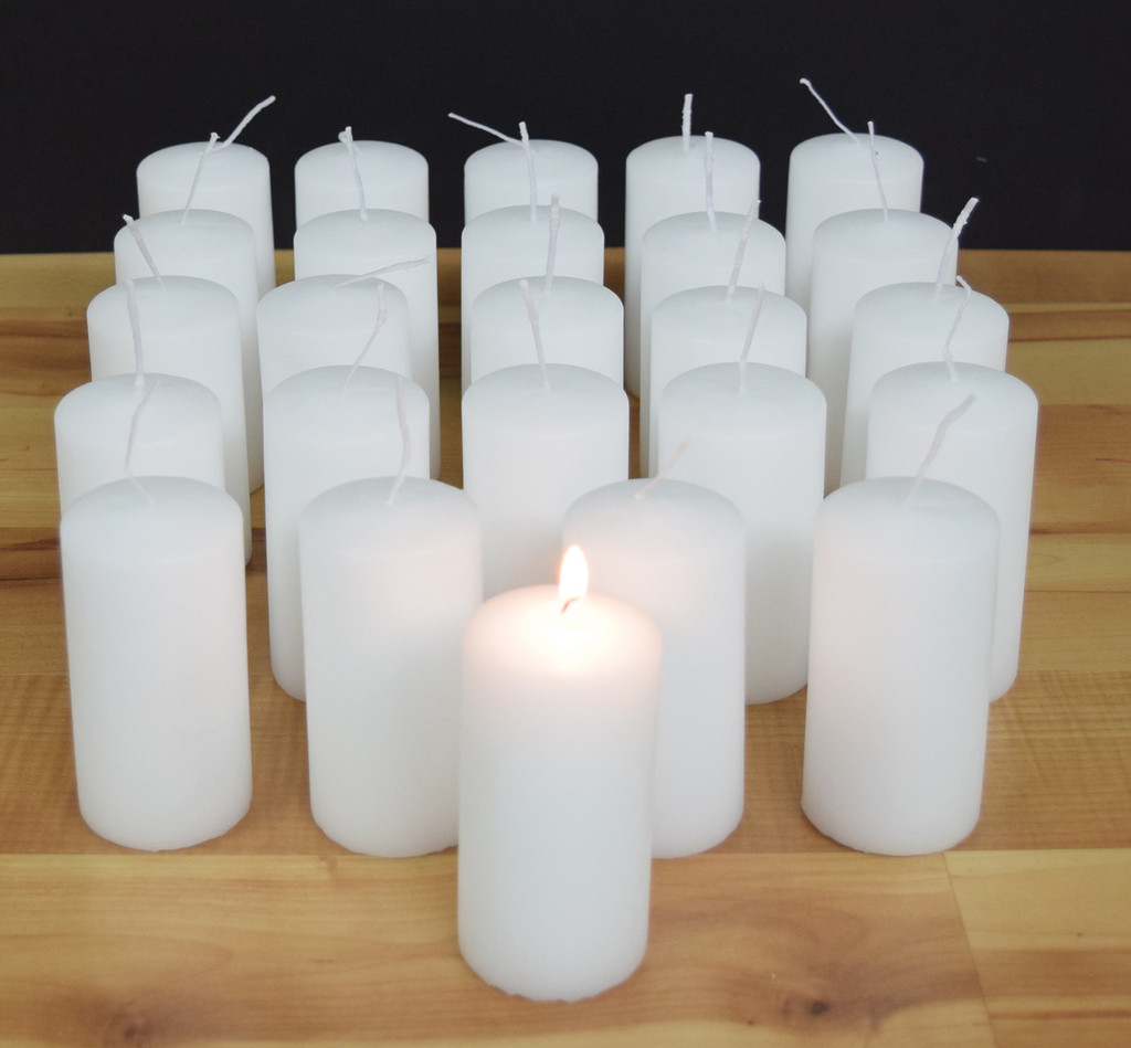 White unscented danish pillars for wedding centerpieces