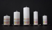 White danish pillar candles in assorted sizes