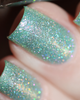AVAILABLE AT GIRLY BITS COSMETICS www.girlybitscosmetics.com Glittering Draught (Little Mermaid Collection) by Femme Fatale | Swatch courtesy of @chrissys_lackwahnsinn