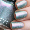 AVAILABLE AT GIRLY BITS COSMETICS www.girlybitscosmetics.com Glittering Draught (Little Mermaid Collection) by Femme Fatale | Swatch courtesy of  @emilydemolly
