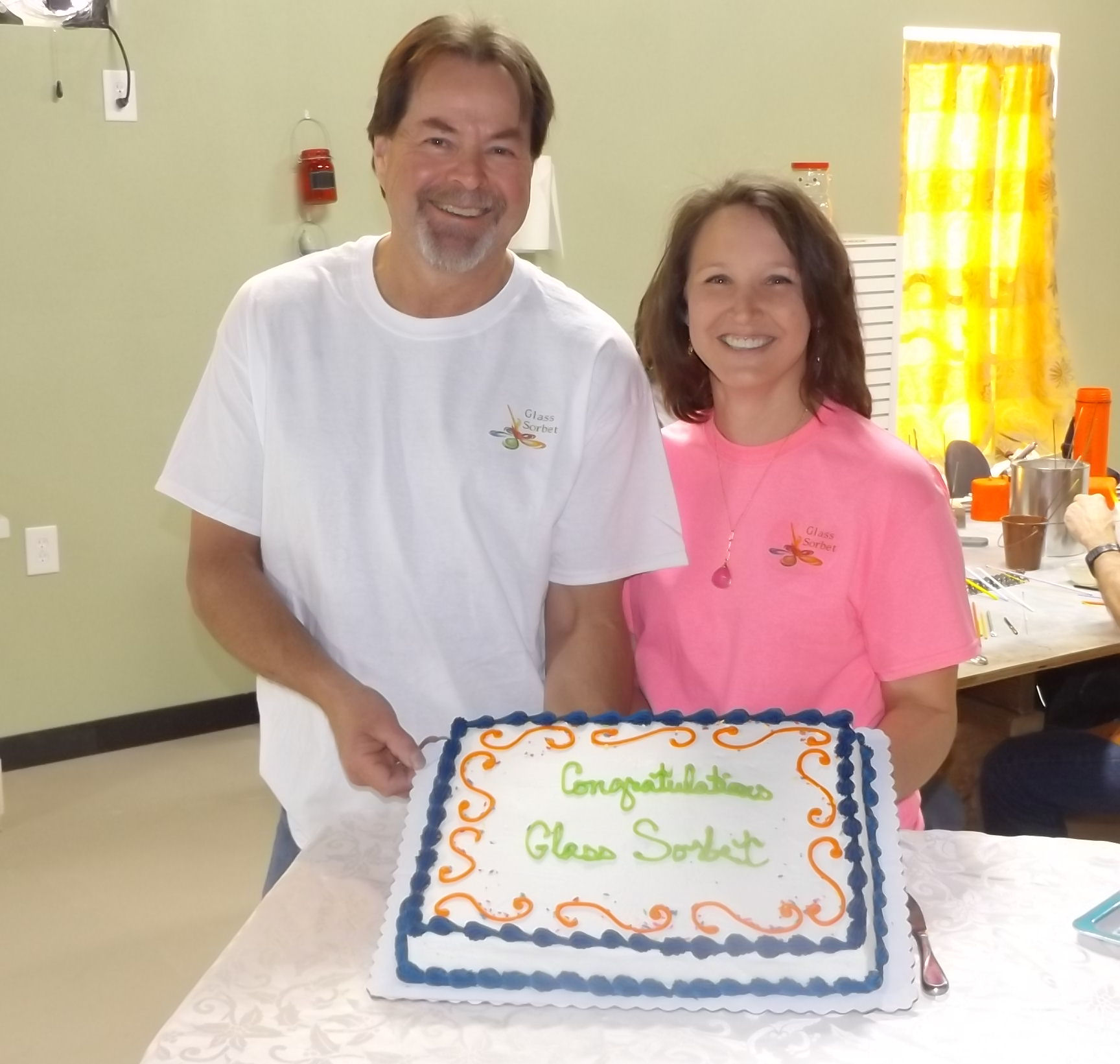 owners-with-cake.jpg