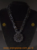 Beautiful black fashion necklace. Flower pendent
