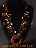 Beaded fashion necklace with large circular pendent