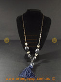 Butterfly detailed necklace with tassel feature