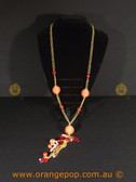 Mixed charmed orange women's necklace
