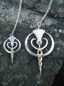 Findhorn Flower Essences large and small pendulums side by side made from gold
