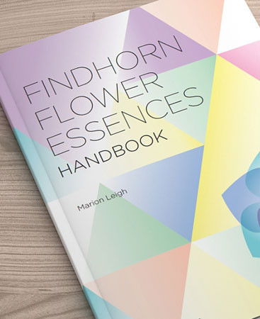 Findhorn Flower Essences Handbook by Marion Leigh on table