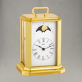 Hermle 8 day brass and crystal striking table clock with moon phase.
