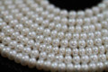 Natural White Center-drilled Button Freshwater Pearls, 7 mm
