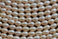 Natural Champagne Peach Center-drilled Rice Freshwater Pearls, 4 - 5 mm