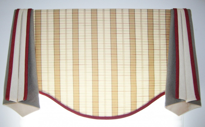 This is a Valance I designed.  It is a simple scalloped bottom with separate side pieces that are lined with a contrasting color.