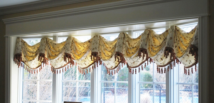 Valance in Kravet 26520-16 and Trim is Robert Allen Tassel Fringe in Sedona. Contrasting fabric inside horns is Kravet 9847-12