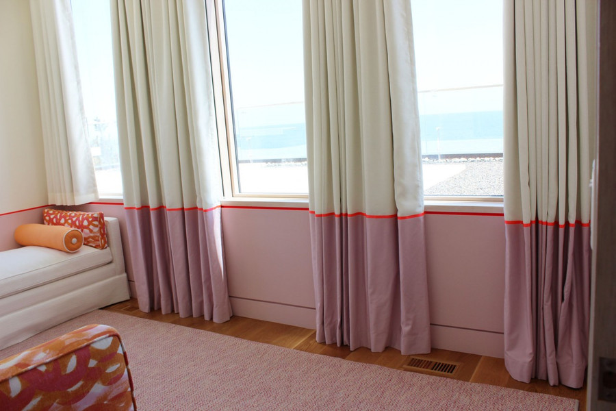 Custom Drapes by Lynn Chalk with border and ribbon trim carefully lined up with painted border on wall.  Bed and Lumbar Pillow covered in Christopher Farr Fathom in Hot Pink.  Designed by Julie Schaffer -Salles Schaffer Architecture.