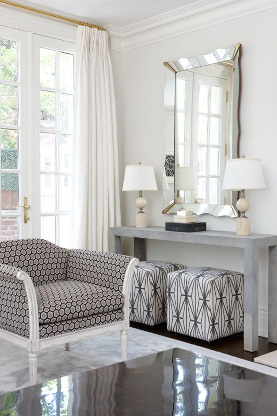 Room Designed by Anne Hepfer.  Ottomans in Kelly Wearstler Katana Ivory/Ebony.