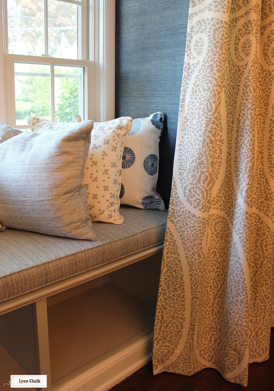 Schumacher Ambala Paisley Fog.   Cushion in Schumacher Travertine Linen Weave in Denim.  Pillows in Groundworks Kasa and Christopher Farr Pollen. (Erika Mercurio Design)