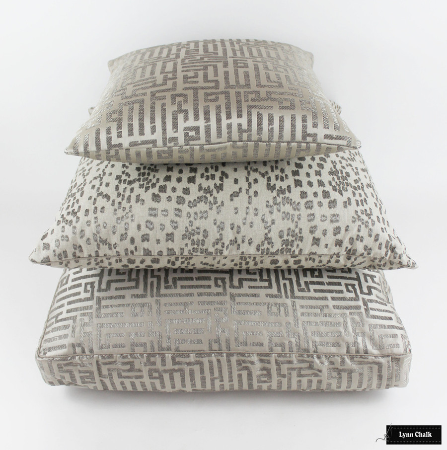 Brunschwig fabric Les Touches Embroidered in Stone in Middle.  Top Pillow and Bottom Cushion in Holly Hunt Written in Code Pale Silver 1129 01 with Welting in Holland and Sherry cord DE97106 BT.