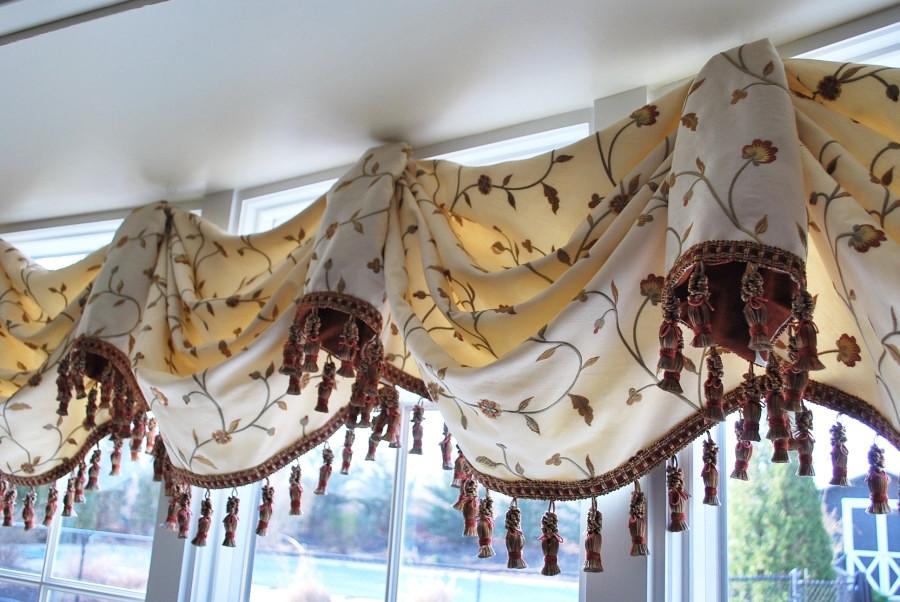 Valance in Kravet 26520-16 and Trim is Robert Allen Tassel Fringe in Sedona. Contrasting fabric inside horns is Kravet 9847-12