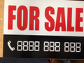 A 4 SALE SIGN WITH DIGITAL NUMBERS THAT MAKE ANY PHONE NUMBER