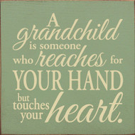 A Grandchild Is Someone Who Reaches For Your Hand But  Wood Sign