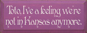 Toto, I've A Feeling We're Not In Kansas Anymore Wood Sign