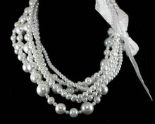 Multi Size and Strand White Luster Pearls with White Ribbon Neck