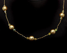 Light Gold Pearl and Small Crystal Necklace on Gold (brown)
