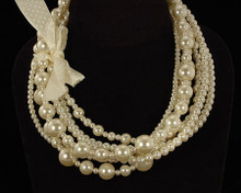 Multi Size and Strand Ivory Luster Pearls with Ivory Ribbon