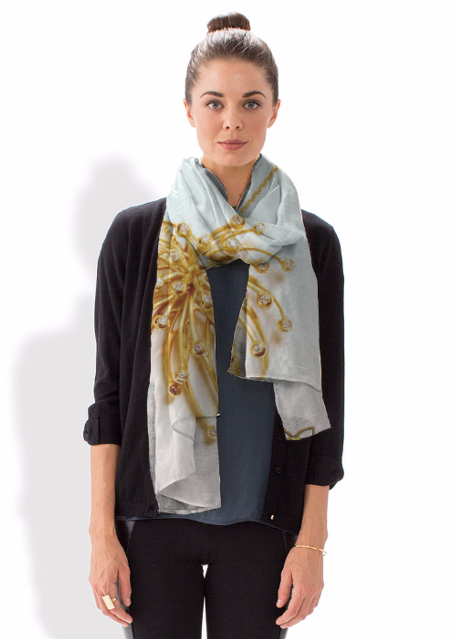 Modal Scarf featuring a photo of the 18K and diamond Superstar fireworks