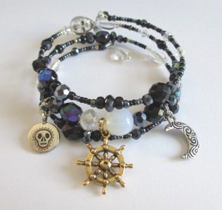 Black luster beads evoke the mystery of fate and fortune on the O Fortuna Bracelet inspired by Carmina Burana by Orf.