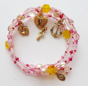 The charms of the Buttercup Bracelet include: the baby feet charm (symbolizing Buttercup's youthful error); the lock and key charm  (symbolizing her secret), and the anchor charm indicating her occupation selling goods to the men of the Navy. Inspired by HMS Pinafore by Gilbert and Sullivan.