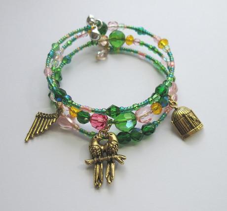 "Beads inspired by the colors of love birds evoke the beloved bird catcher, Papgeno (""Der Vogelfänger bin ich ja""), from Mozart's The Magic Flute."