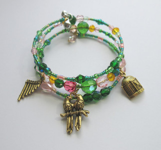 "Beads inspired by the colors of love birds evoke the beloved bird catcher, Papgeno (""Der Vogelfänger bin ich ja""), from Mozart's The Magic Flute."