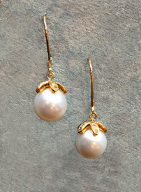 White South Sea Pearls earrings, 18k gold with diamond petals