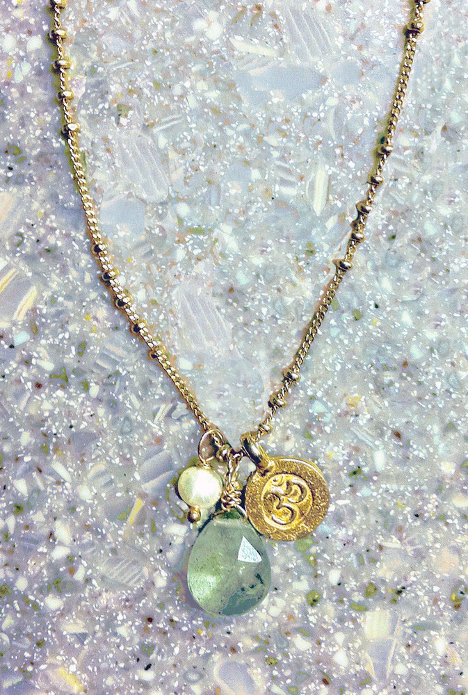 Moss Aquamarine necklace with an OM charm
