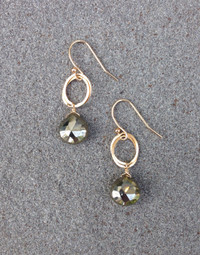 Shiny brown pyrite stones hand from gold filled flat rings.