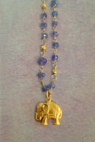Tanzanite stones on a vermeil wire wrapped chain, a lucky vermeil elephant charm completes the look! Shiny vermeil beads randomly spaced throughout the tanzanite necklace- and it can be worn doubled too.