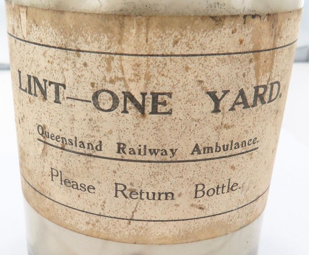 "Rarer early 1900s QLD Railway Ambulance ""Lint, One Yard"" glass jar + contents"