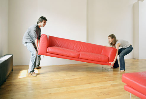 Couple Moves Red Couch into Home