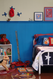 A boy's bedroom featuring painted birch beadboard