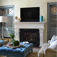 A traditional cast stone mantel in Linen limestone color